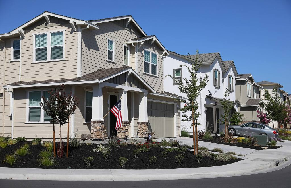 Affordable housing units, such as this duplex on the corner of Winterberry Lane, have been incorporated into the Willowglen subdivision in Rohnert Park.(Christopher Chung/ The Press Democrat)