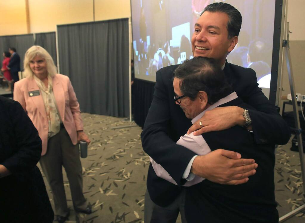 Herman Hernandez, Founder and Chairman of Los Cien, with glasses, greets California Secretary of State Alex Padilla after Padilla gave the keynote address at Los Cien's third State of the Latino Community in Sonoma County, Thursday Sept. 29, 2016 at Sonoma State University in Rohnert Park. At left is Sonoma County Supervisor Susan Gorin. (Kent Porter / Press Democrat) 2016