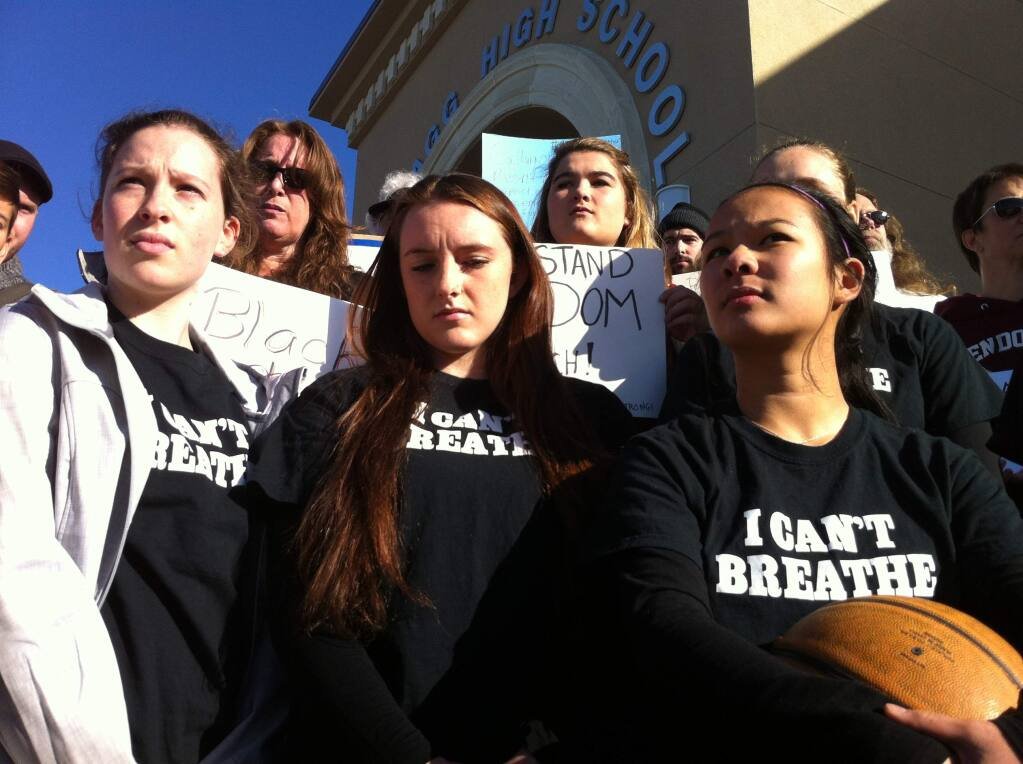 """The Mendocino High School girls basketball team rallies outside the Fort Bragg hoops tournament after being banned for wearing shirts emblazoned with """"I can't breathe"""" on Monday, Dec. 29, 2014. (BETH SCHLANKER / PD)"""