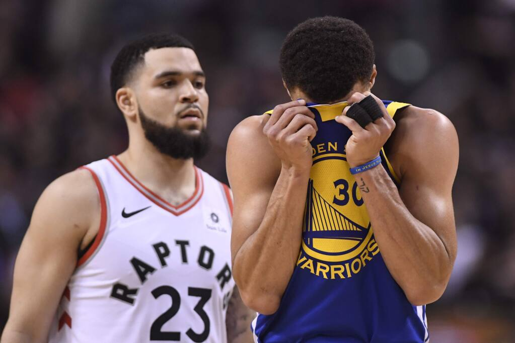 Golden State Warriors guard Stephen Curry (30) reacts in front of Toronto Raptors Fred VanVleet during the second half of Game 1 of the NBA Finals, Thursday, May 30, 2019, in Toronto. (Frank Gunn/The Canadian Press via AP)