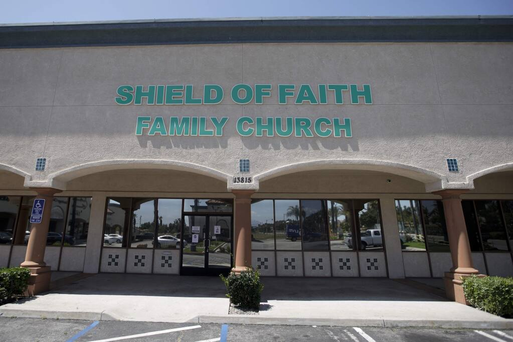 FILE - In this April 14, 2020, file photo, Shield of Faith Family Church stands in Fontana, Calif. A federal judge on Wednesday, April 22, said he will deny a bid by three Southern California churches, including Shield of Faith Family Church, to hold in-person church services during the coronavirus pandemic, saying that government's emergency powers trump what in normal times would be fundamental constitutional rights. (AP Photo/Chris Carlson, File)