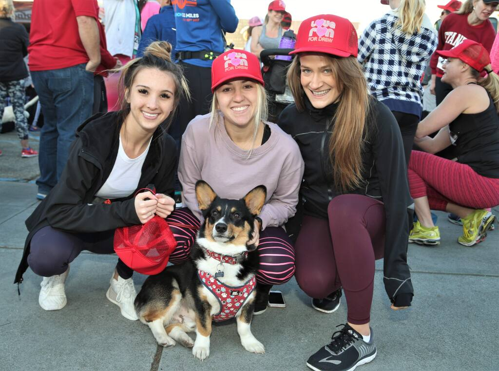From left, Kamran Heth, Chelsea Macri, Mehgan Holt and Winston at the start line of the 5K run. Hundreds of runners came to Healdsburg Saturday, February 10th, 2018 to participate in the 'Love Run for Drew'. The 5K run organized by the Healdsburg Running Company benefits the Drew Esquivel Memorial Scholarship which helps kids attend college. (Photos Will Bucquoy/for the Press Democrat)
