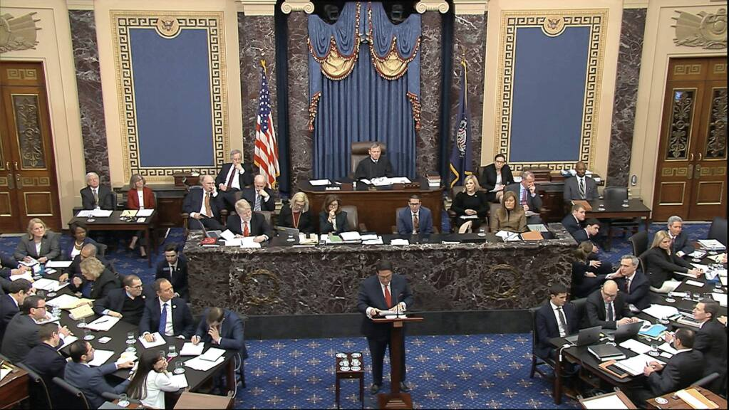 In this image from video, personal attorney to President Donald Trump, Jay Sekulow, hold a copy of the Mueller Report as speaks during the impeachment trial against Trump in the Senate at the U.S. Capitol in Washington, Saturday, Jan. 25, 2020. (Senate Television via AP)
