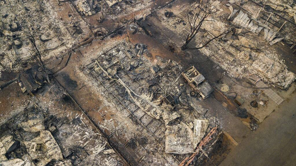Debris and residences leveled by the wildfire line a neighborhood in Paradise, Calif., on Thursday, Nov. 15, 2018. The California Department of Forestry and Fire Protection said Thursday the wildfire that destroyed the town of Paradise is now 40 percent contained, up from 30 percent Wednesday morning. (AP Photo/Noah Berger)