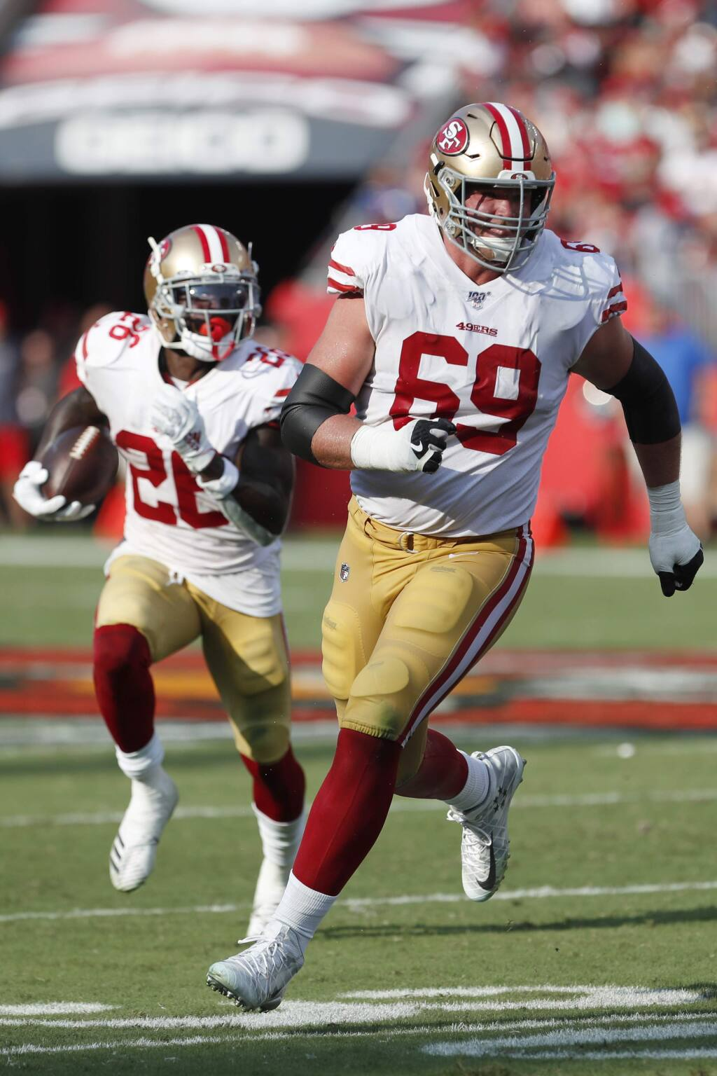 San Francisco 49ers offensive tackle Mike McGlinchey, right, looks to block for running back Tevin Coleman against the Tampa Bay Buccaneers during the first half, Sunday, Sept. 8, 2019, in Tampa, Fla. (AP Photo/Mark LoMoglio)