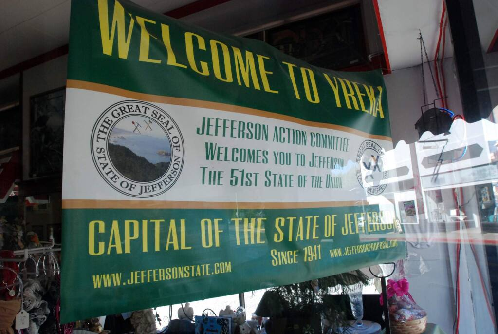 In this Sept. 6, 2013 photo, a banner welcoming visitors to the State of Jefferson hangs in the window of a downtown business in Yreka, Calif. (AP Photo/Jeff Barnard)