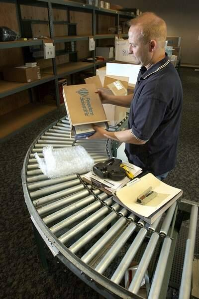 Bob Oliver, who manages shipping and receiving for GC Micro, puts together orders at the Petaluma office in 2007. (Scott Manchester / The Press Democrat)