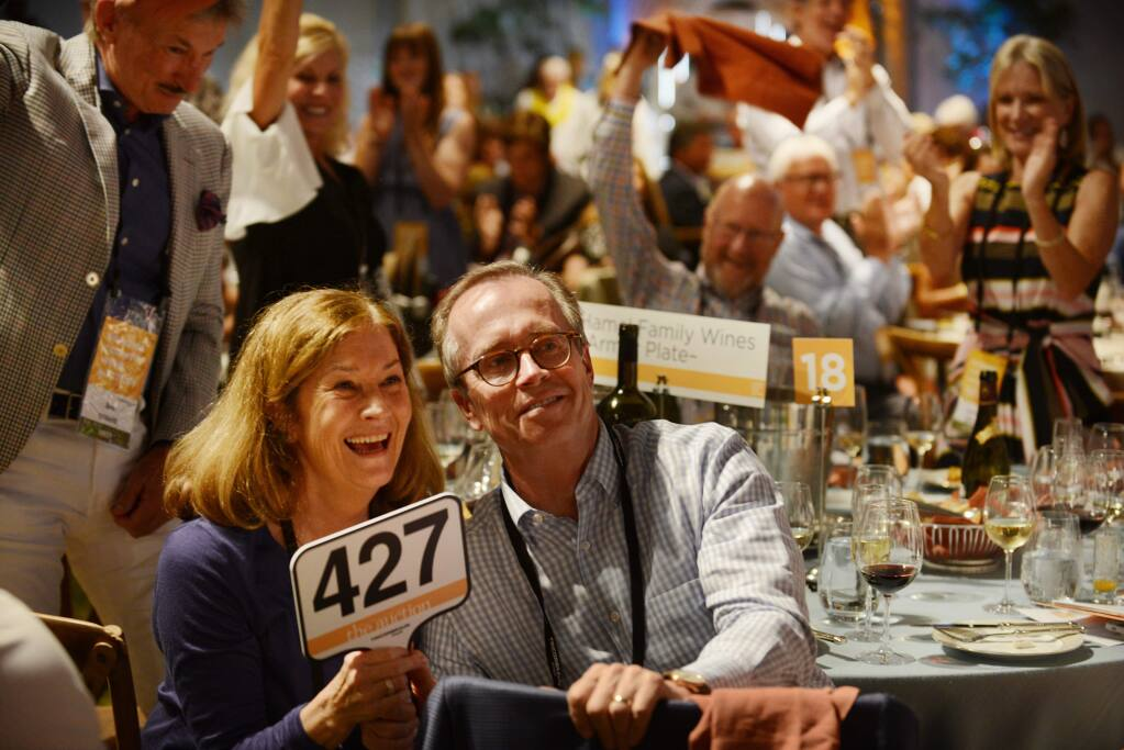 Pamela Hamel, left, and George Hamel Jr. of Hamel Family Wines being generous at the Sonoma County Wine Auction in 2017. Those proceeds are being distributed now.(Photo: Erik Castro/for The Press Democrat)
