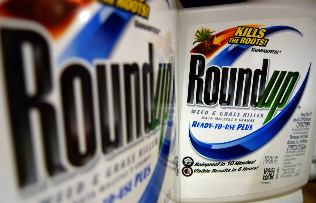 Bottles of Roundup herbicide, a product of Monsanto, are displayed on a store shelf Tuesday, June 28, 2011, in St. Louis. (AP Photo/Jeff Roberson)