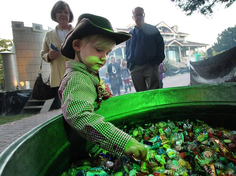 Jameson Manville, 3, reaches for candy being given out at the McDonald Mansion in Santa Rosa on Thursday, October 31, 2013. (Conner Jay/The Press Democrat)