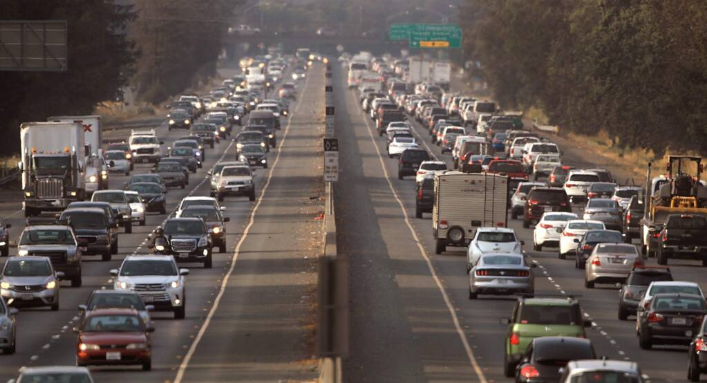 Highway 101 is packed with afternoon commuters between Todd Road and Hearn Avenue, Thursday, August 23, 2018 in Santa Rosa. During the past decade, car trips on the highway have risen 20 percent. (Kent Porter / The Press Democrat) 2018