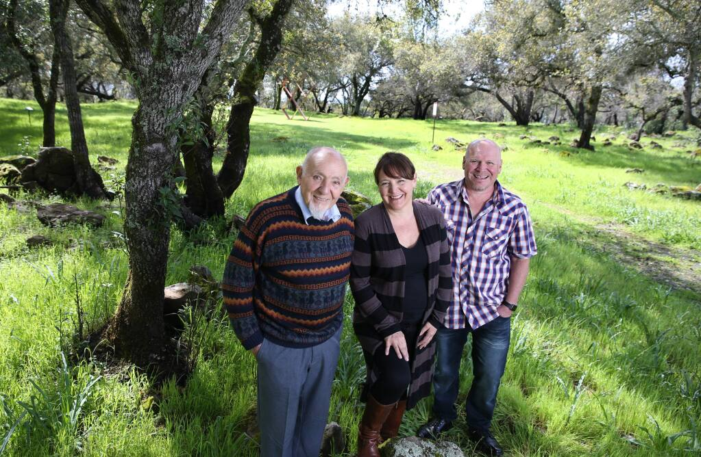 Founder Walter Byck, left, his daughter Sonia Byck-Barwick, and his son Rene Byck stand in Marijke's Grove at Paradise Ridge Winery in Santa Rosa, California on Tuesday, March 26, 2019. (BETH SCHLANKER/The Press Democrat)