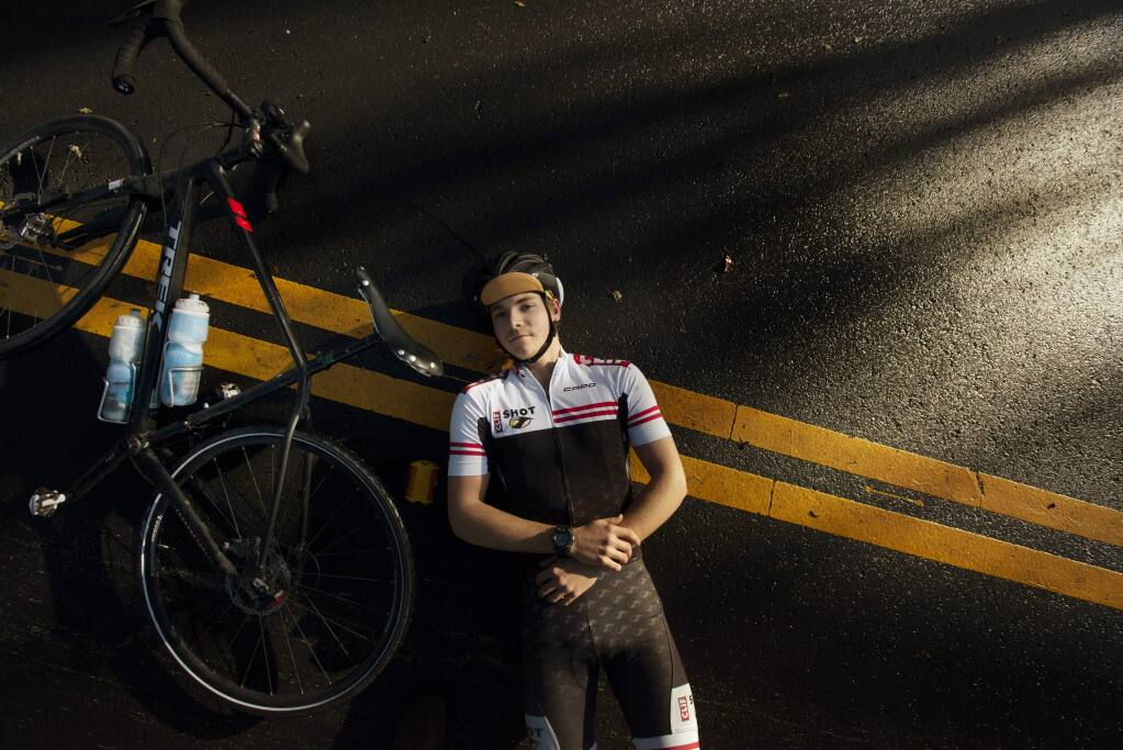"""Oliver Cannard, 18, a Sonoma Valley High School graduate recently completed a solo bike ride across the US. During his 4,228 miles trek he was attacked by dogs in Missouri and once had his jacket brushed by a side-view mirror from a speeding car. """"I remember sometimes, I just listened to my tires on the pavement. It was soothing,"""" said Cannard, photographed on Irwin Lane in Santa Rosa, California. December 1, 2018.(Photo: Erik Castro/for The Press Democrat)"""