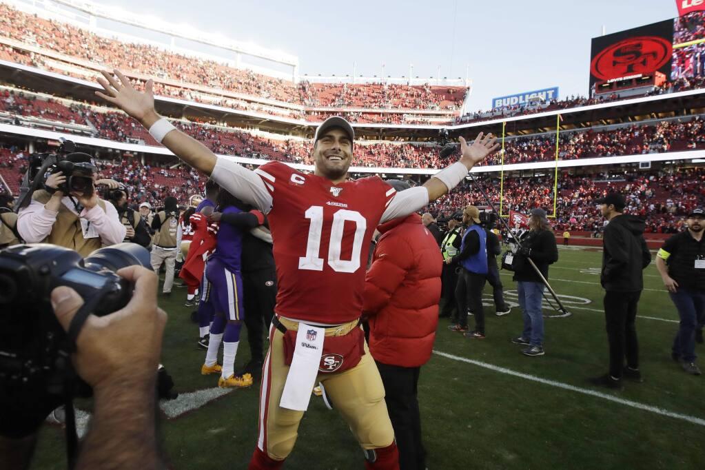 San Francisco 49ers quarterback Jimmy Garoppolo celebrates after the 49ers beat the Minnesota Vikings 27-10 in an NFL divisional playoff game, Saturday, Jan. 11, 2020, in Santa Clara. (AP Photo/Ben Margot)
