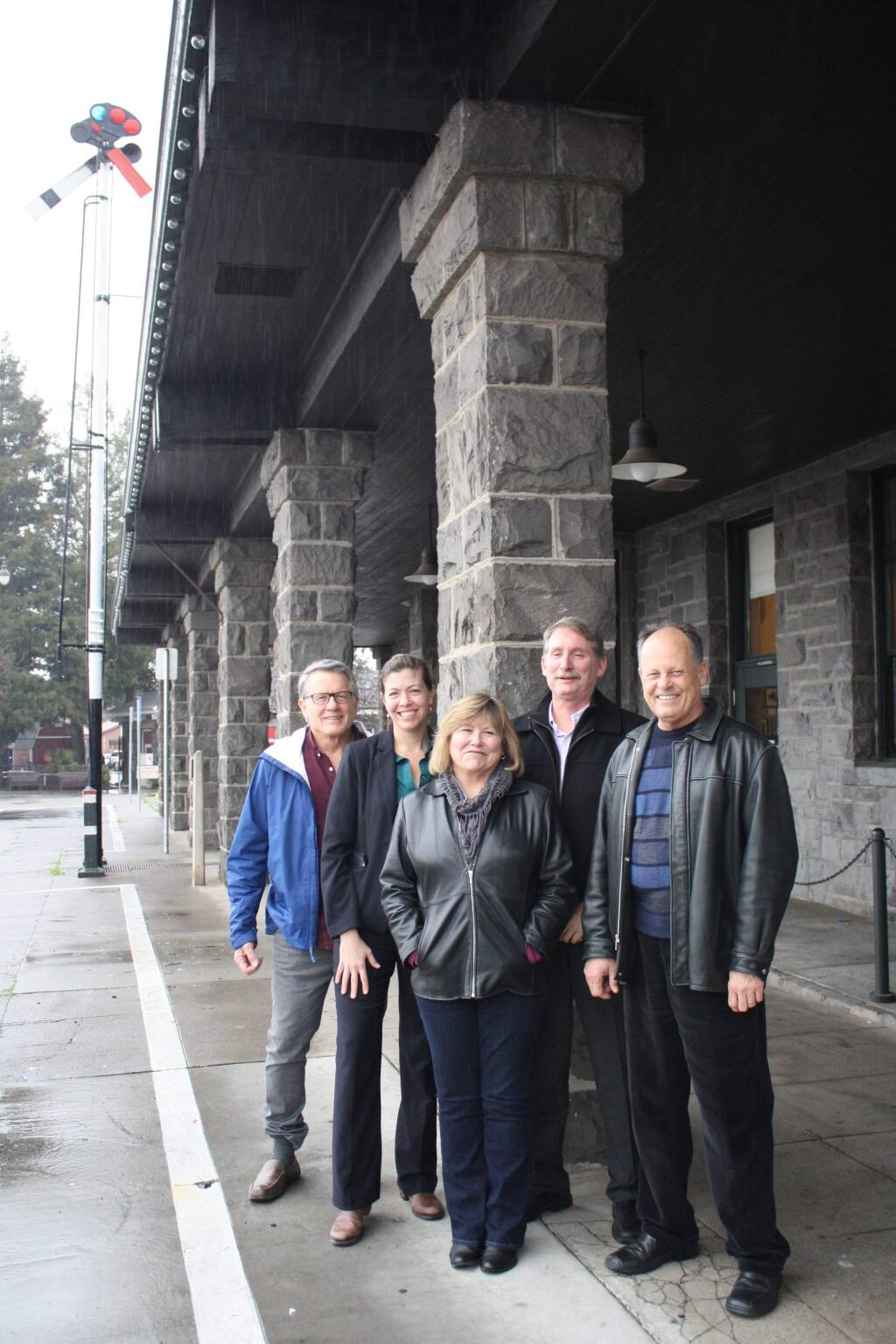 Urban Community Partnership founders (from left) David Petritz, Robin Stephani, Karen Weeks, Peter Stanley and Mitch Conner in front of the still undeveloped Railroad Square SMART station in Santa Rosa on Jan. 14, 2016. Paul Fritz is not pictured. (Gary Quackenbush / North Bay Business Journal)