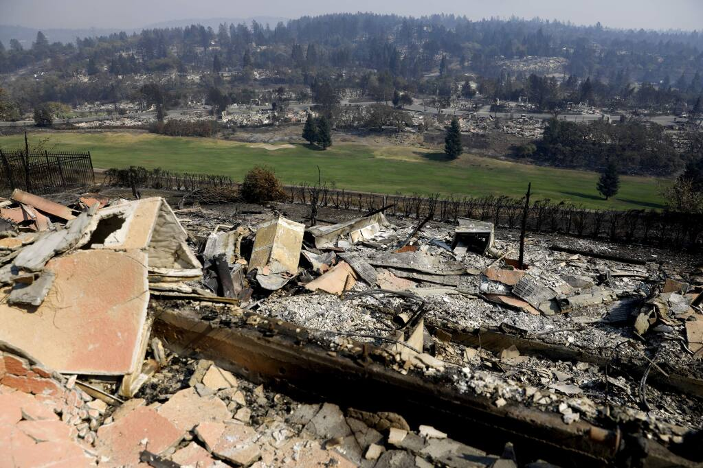 The rubble of homes burned surrounding the golf course in the Fountaingrove area of Santa Rosa, on Sunday, Oct. 15, 2017. (BETH SCHLANKER/ The Press Democrat)