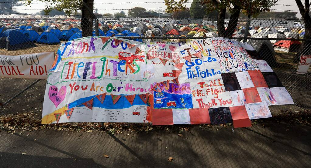 Signs are appearing all over Sonoma County, especially at the Sonoma County Fairgrounds in Santa Rosa, thanking first responders. (Kent Porter / Press Democrat) 2017