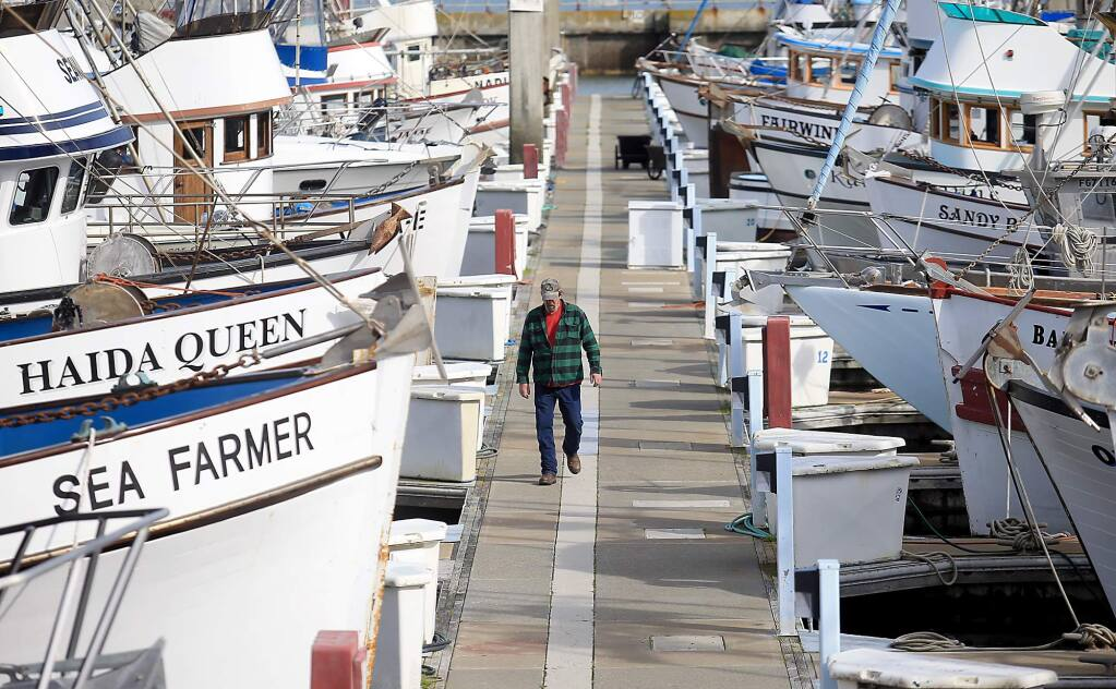 Mike Duer of the Sandy B, captained by Stan Carpenter, works on the boat at Spud Point Marina,Thursday Feb. 4, 2016. (KENT PORTER/ PD FILE)