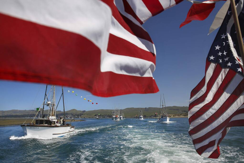 The Suzan E, left, joins a number of other fishing boats during the Boat Parade as part of the 42nd annual Bodega Bay Fisherman's Festival on Sunday, April 12, 2015 in Bodega Bay, California . (BETH SCHLANKER/ The Press Democrat)