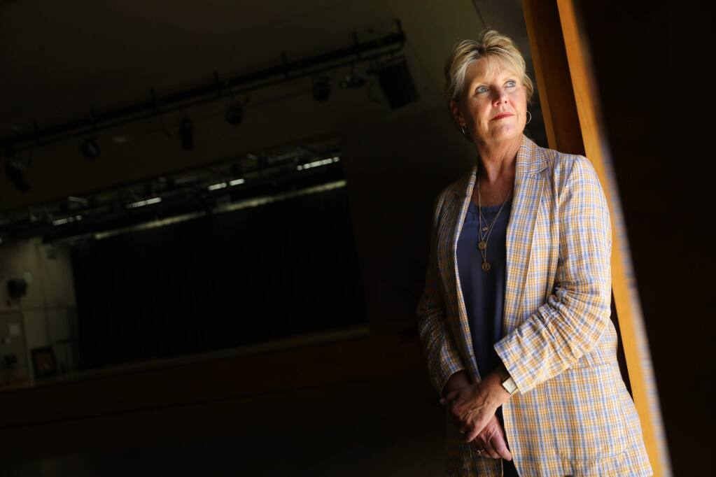 Kelley Magnuson, deputy recreation director for the City of Santa Rosa, who lost her home in the Tubbs fire, helped house evacuees at the Finley Community Center. Magnuson is part of a wildfire documentary reflecting on the Tubbs fire.(Christopher Chung/ The Press Democrat)