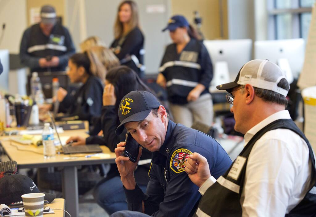 From right, Santa Rosa City Manager Sean McGlynn works with Santa Rosa County Assistant Fire Marshal Paul Lowenthal at the Santa Rosa Emergency Operations Center on Thursday. (photo by John Burgess/The Press Democrat)
