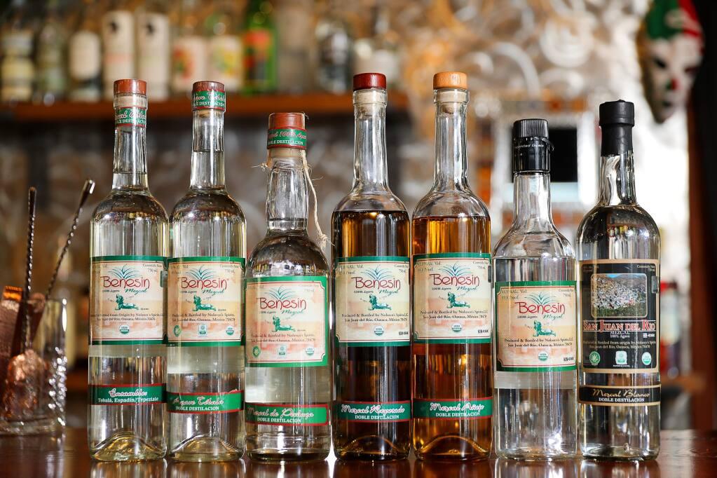 Bottles of Benesin Mezcal, and San Juan del Rio Mezcal, produced by master distiller Efrain Nolasco.(Christopher Chung/ The Press Democrat)
