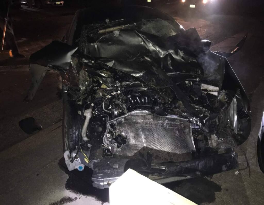 Police say a suspected drunken driver crashed into two parked vehicles then walked away from the wreck, early Monday, June 4, 2018. The driver was later arrested. (SANTA ROSA POLICE DEPARTMENT)