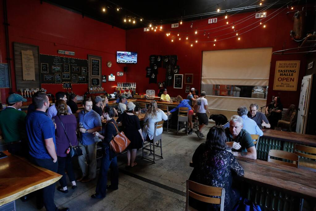 Customers enjoy live music, craft brews and conversation at Moonlight Brewing Company in Santa Rosa, California, on Thursday, July 18, 2019. (Alvin Jornada / The Press Democrat)