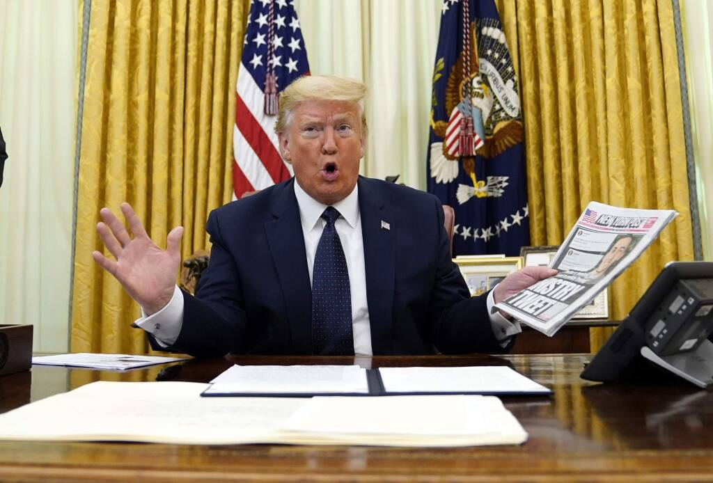 President Donald Trump speaks before signing an executive order aimed at curbing protections for social media giants, in the Oval Office of the White House, Thursday, May 28, 2020, in Washington. (AP Photo/Evan Vucci)