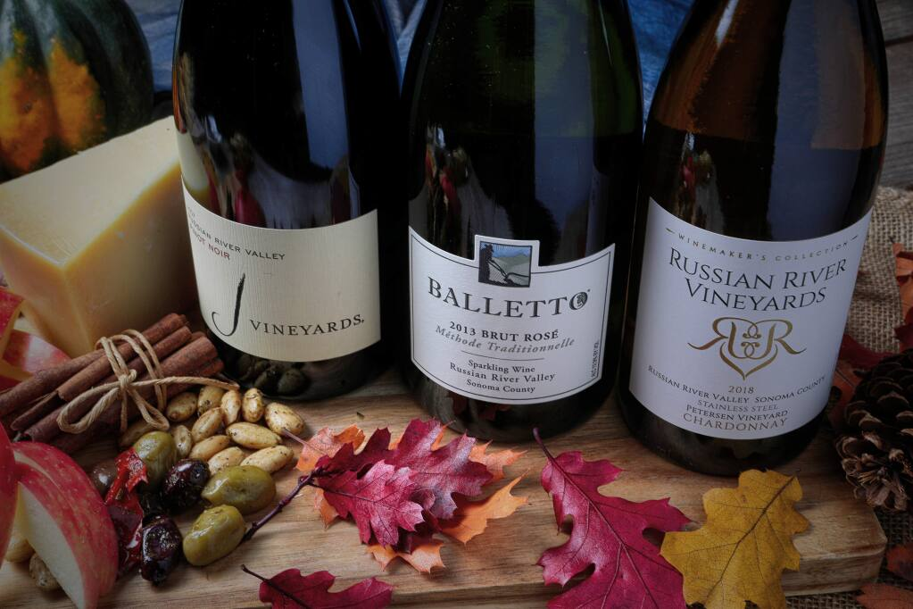 J Vineyards' 2017 Russian River Valley pinot noir, left, received the sweepstakes award for red wines at the 2019 Harvest Fair awards gala on Sunday, Sept. 29, 2019 at Luther Burbank Center for the Arts in Santa Rosa. Balletto Vineyards' 2013 Sparkling Brut rosé, middle, received the sweepstakes award for specialty wines. Russian River Vineyards' 2018 Petersen Vineyard chardonnay received the sweepstakes award for white wines. (WILL BUCQUOY)