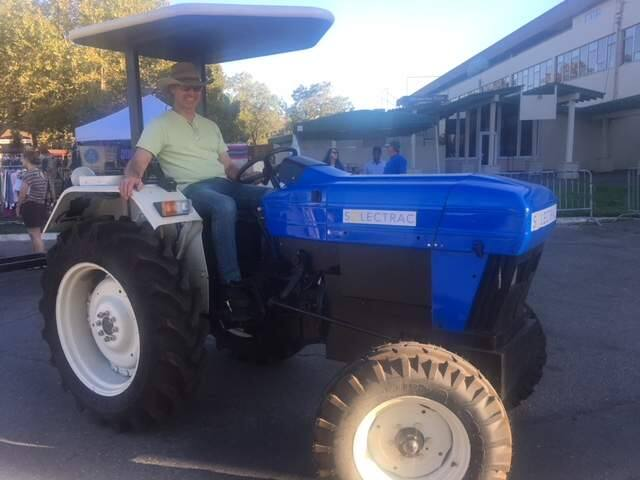 Steve Heckeroth of Mendocino County and his electric tractor at the National Heirloom Expo. (Chris Smith / The Press Democrat)