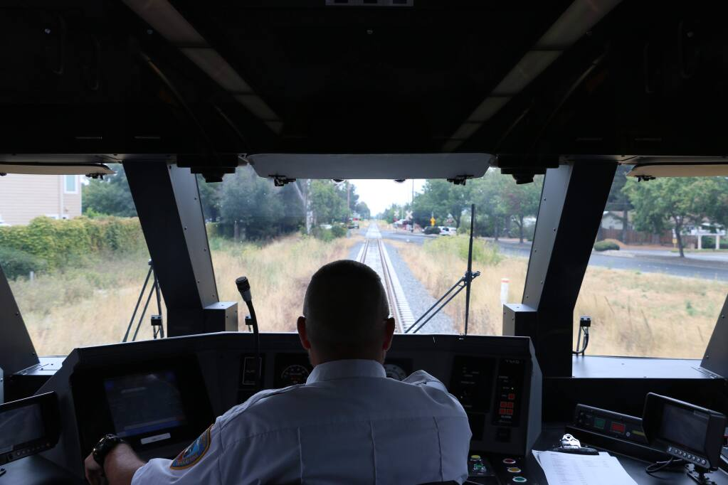 Scott Mitchell, one of 11 train engineers for Sonoma-Marin Area Rail Transit system, takes the public on a test ride in August 2016. (ANGELA HART/ PD FILE)