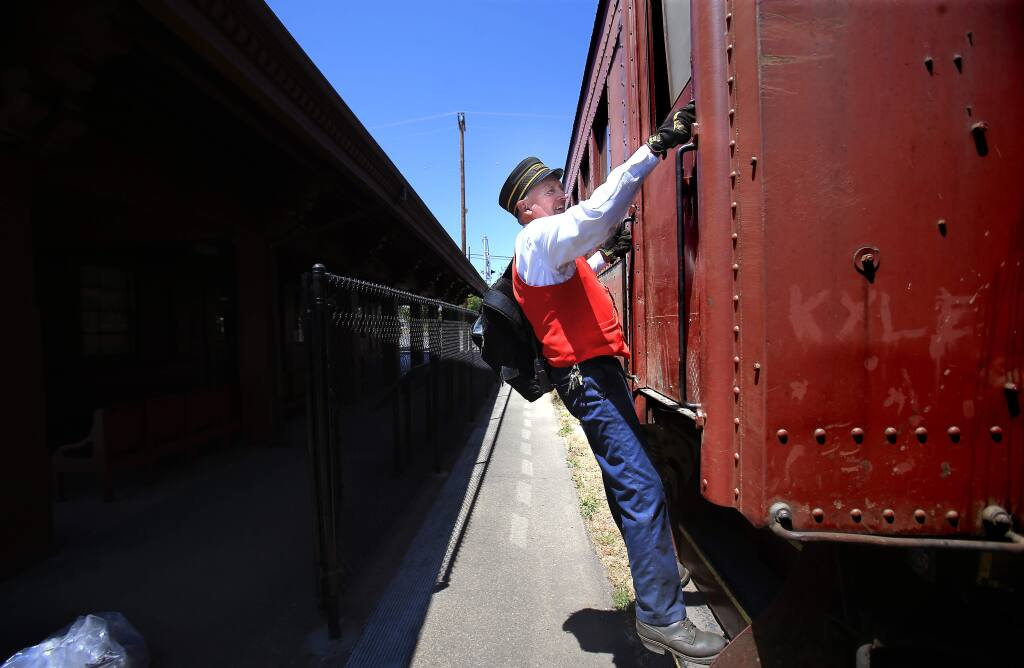 Skunk Train conductor Glen Ford locks up at the Willits depot after a day of riding the rails on Thursday, July 2, 2015. (KENT PORTER/ PD)