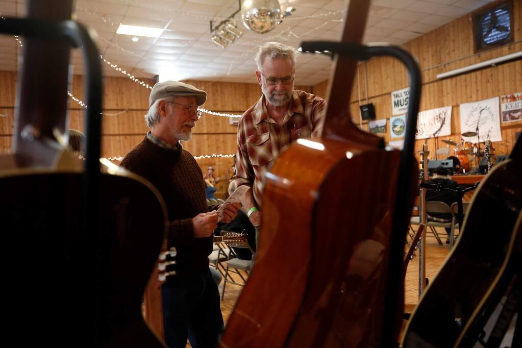 Jeff Davis, left, admires Stephen Smith's collection of guitars that are on display during the seventh annual Sebastopol Guitar Festival at the Sebastopol Community Cultural Center in Sebastopol, California, on Saturday, February 2, 2019. (Alvin Jornada / The Press Democrat)