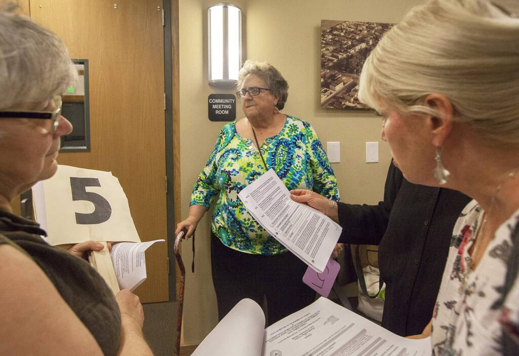 Kathy King (center), executive director of Sonoma Overnight Support, waits outside the community meeting room for their agenda item on a safe parking program in Sonoma be addressed last September. After a three-month trial, King elected not to appy for an extension. (Photos by Robbi Pengelly/Index-Tribune)
