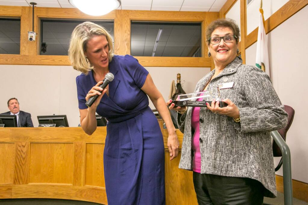 Madolyn Agrimonti (right) is presented with a crystal gavel in recognition of her service as mayor by Amy Harrington at the Sonoma City Council meeting Dec. 10, 2018. (Photo by Julie Vader/special to the Index-Tribune)