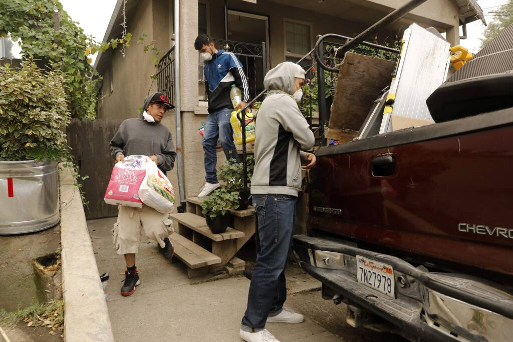 Residents load up their truck as they evacuate on Wednesday, October 11, 2017 in Boyes Hot Springs, California . (BETH SCHLANKER/The Press Democrat)