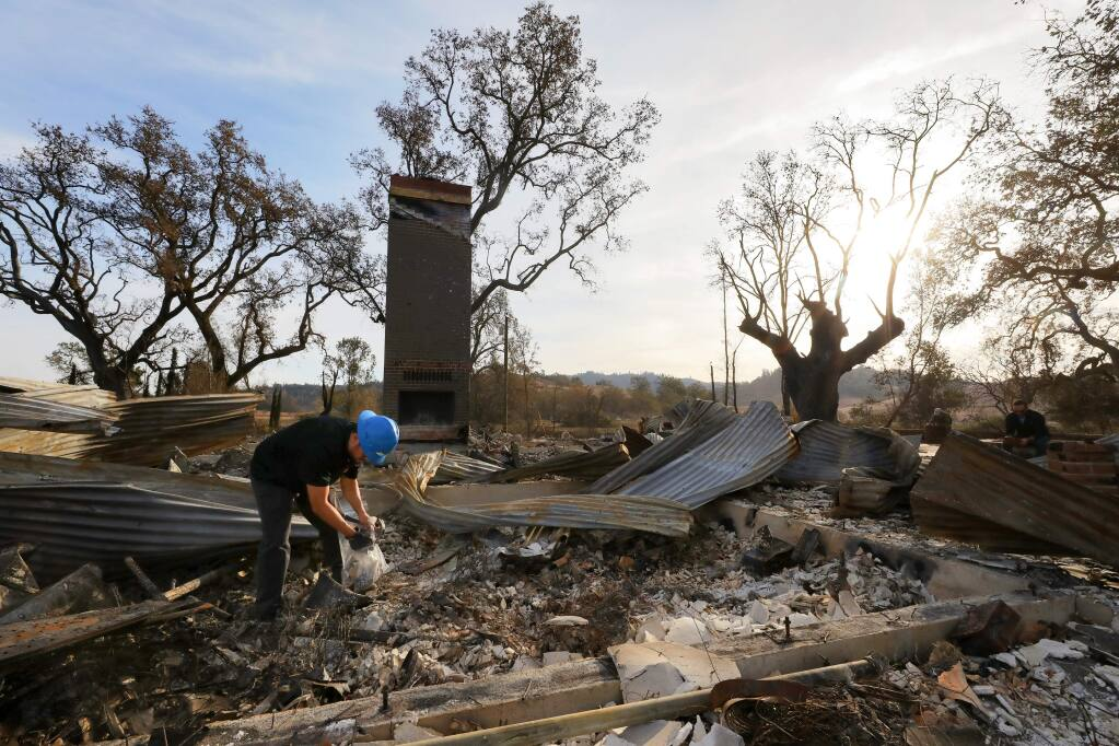 Max Yourman, of Patriot Environmental Laboratory Services, Inc., collects debris samples for hazardous waste profiling, which is the first step in the debris removal process, at the main house on the Newman ranch property near Calistoga on Monday, November 11, 2019. Six residences on the property were destroyed by the recent Kincade fire.(Christopher Chung/ The Press Democrat)