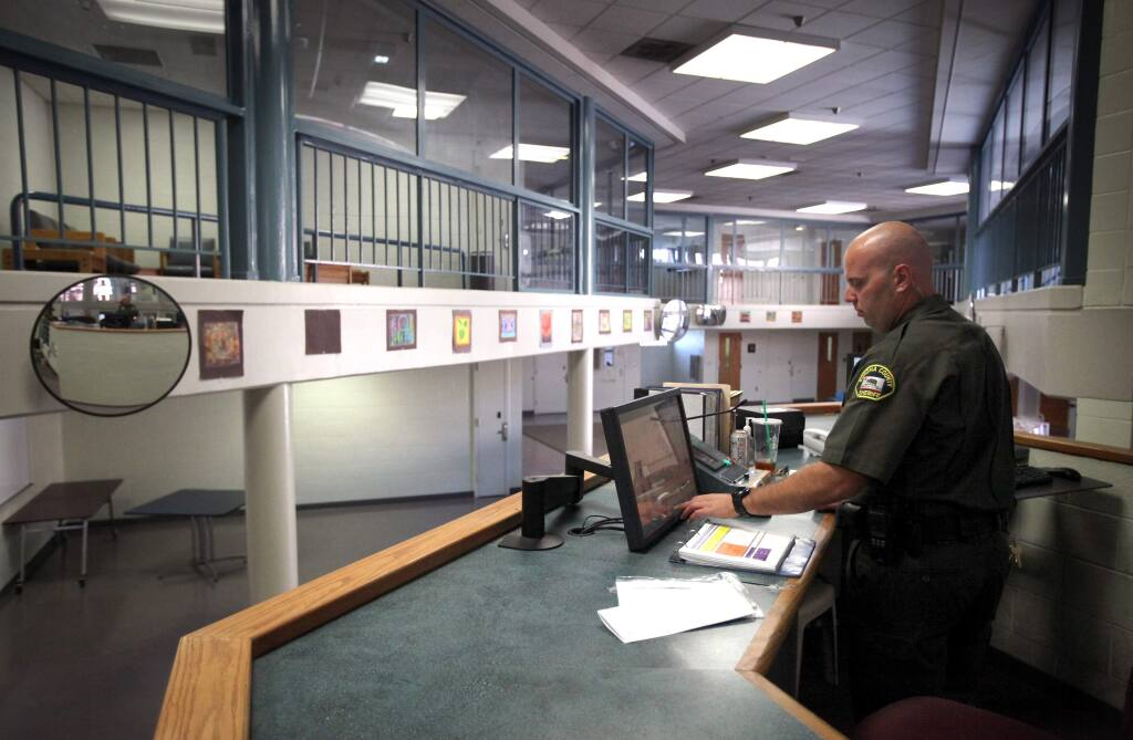Sonoma County Correctional Deputy Nick Lund works in the F-Module, mental health unit, of the Sonoma County Jail, in Santa Rosa, on Wednesday, July 31, 2013. (Christopher Chung/ The Press Democrat)