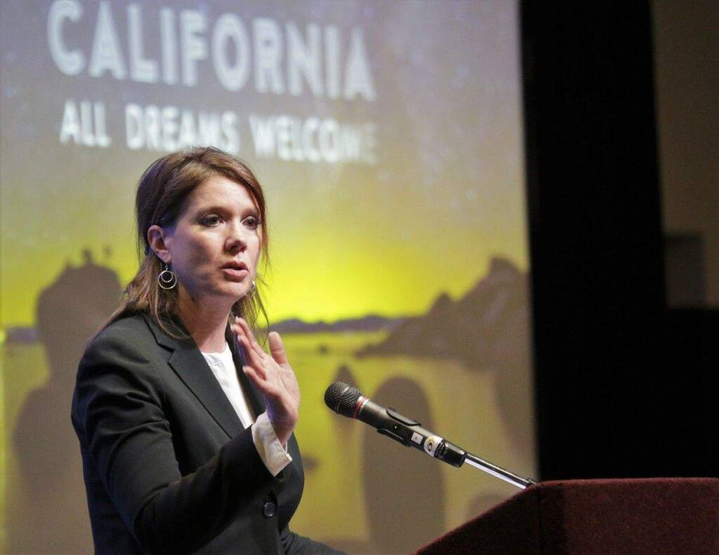 Visit California's Caroline Beteta explains the state has recorded seven straight years of growth in the travel sector, speaking at Sonoma County Tourism's annual breakfast meeting April 11, 2017, at Santa Rosa's Hyatt Vineyard Creek. (Will Bucquoy)