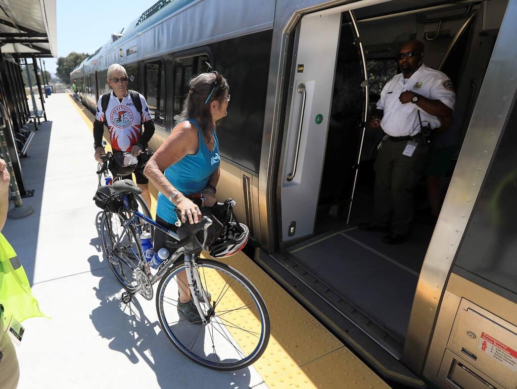 Passengers board a SMART train at the Airport Boulevard station in Santa Rosa on Friday, Aug. 25, 2017. (KENT PORTER / Press Democrat)