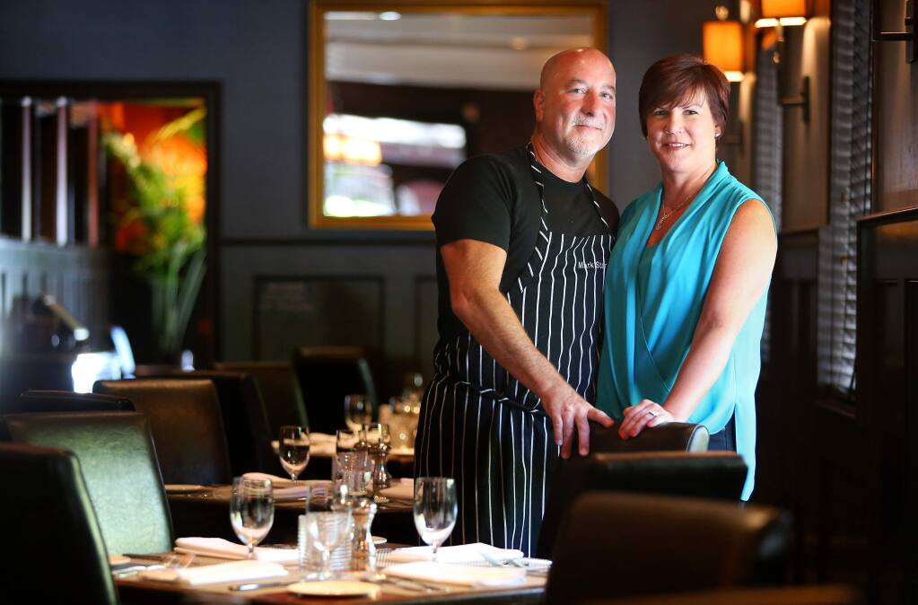 Mark and Terri Stark at Stark's Steak & Seafood, in Santa Rosa on Tuesday, July 8, 2014. The couple also owns Bravas Bar De Tapas, Willi's Wine Bar, Willi's Seafood & Raw Bar, and Monti's Rotisserie & Bar, and are getting ready to open a sixth restaurant in Sonoma County.(Christopher Chung/ The Press Democrat)