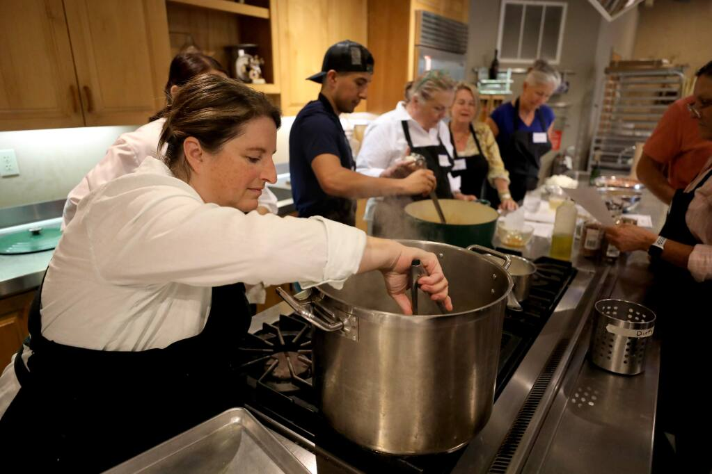 Chef Annie Simmons checks on artichokes boiling in water during a 'Cowboy Cuisine' cooking class at Ramekins Culinary School in Sonoma on Sunday, Sept. 22, 2019. (BETH SCHLANKER/ PD)