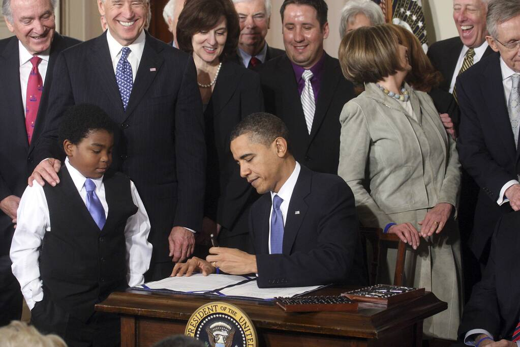 President Barack Obama signs the Affordable Care Act into law on March 23, 2010. House Republicans plan to vote today to repeal the law. (DOUG MILLS / New York Times)