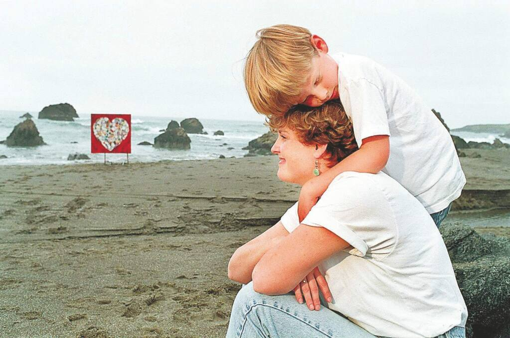 THE PRESS DEMOCRAT, FileNancy Witherell Bellen, with her son Wiley at her favorite beach north of Bodega Bay in 1996, after she was diagnosed with breast cancer. In the background is the heart collage she made from get well cards.