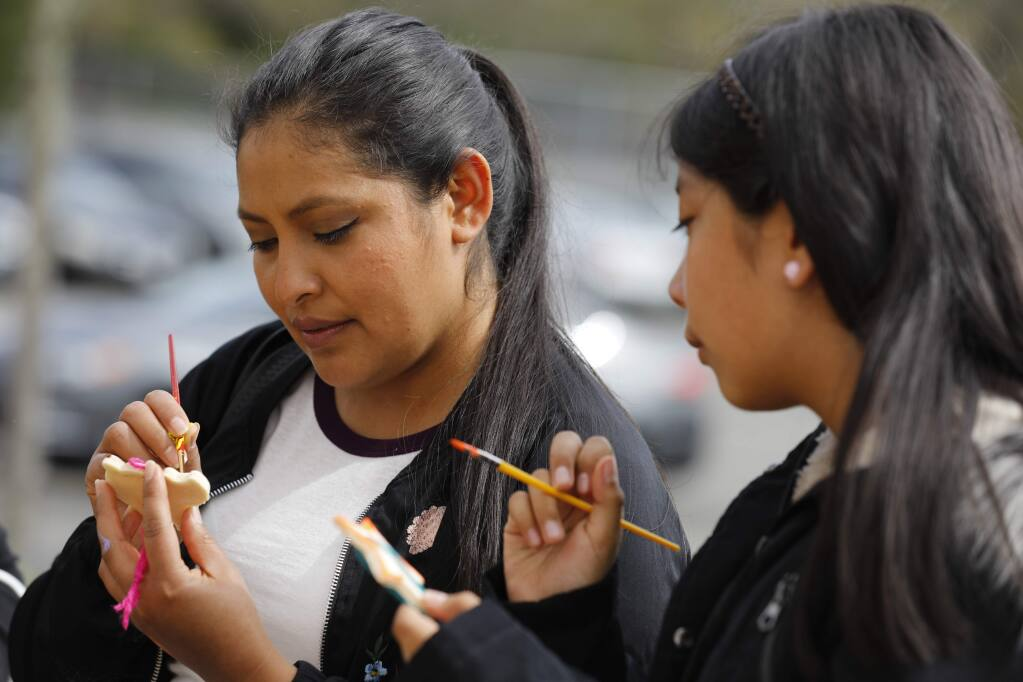 Fany Vargas, left, paints salt dough ornaments with her daughter Maria Perez Vargas, 10, during a Oaxacan Carnival and Health Fair event at the Healdsburg Community Center in Healdsburg, California on Sunday, April 7, 2019. (BETH SCHLANKER/The Press Democrat)