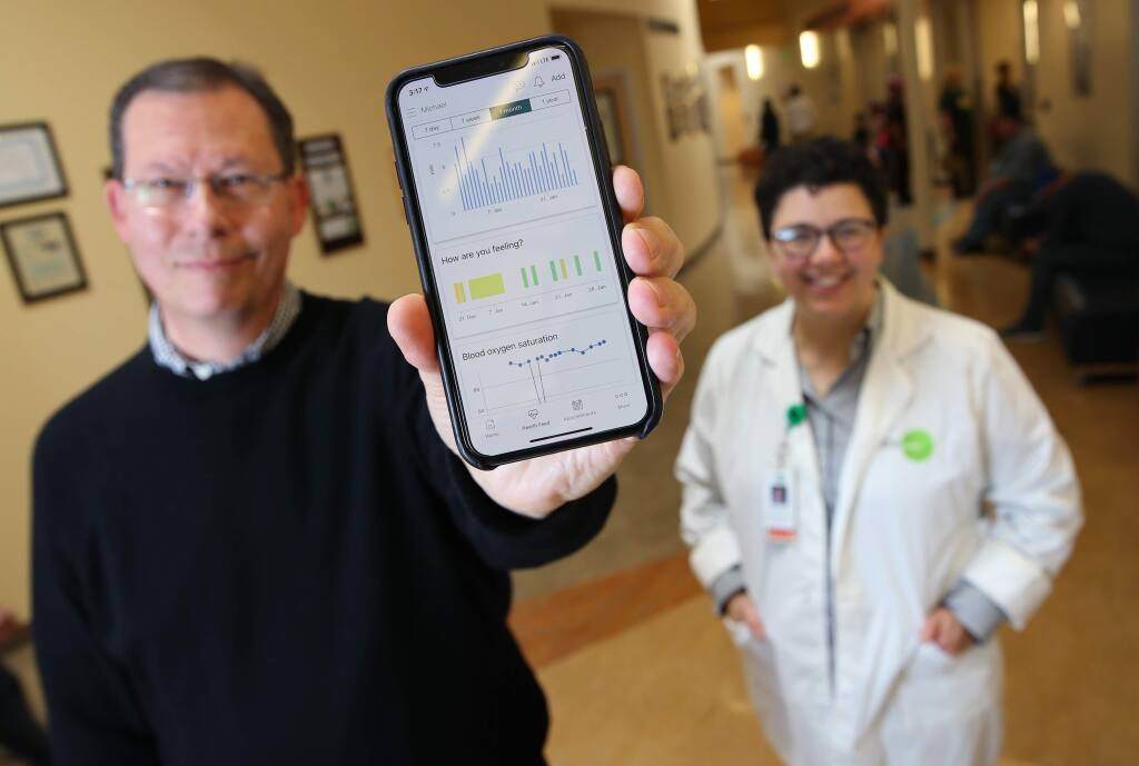 Michael Hatfield the Executive Chairman of Carium, and Dr. Danielle Oryn, the Chief Medical Informatics Officer, have been testing a new health care management app. Photo taken at the Petaluma Health Center in Petaluma on Tuesday, January 29, 2019. (BETH SCHLANKER/ The Press Democrat)