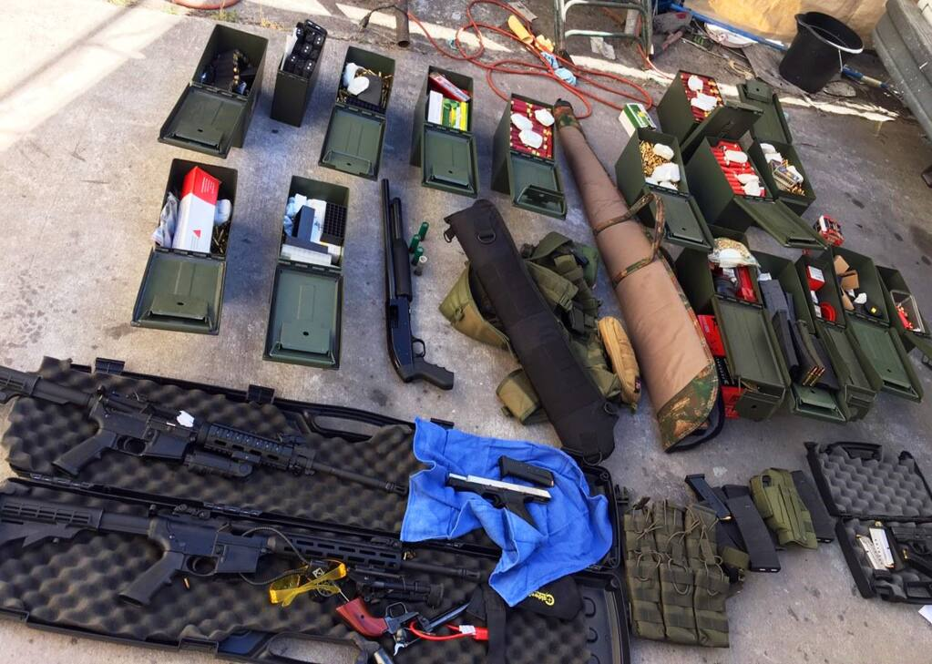 This undated photo released Wednesday, Aug. 21, 2019 by the Long Beach, Calif., Police Department shows weapons and ammunition seized from a cook at a Los Angeles-area hotel who allegedly threatened a mass shooting. Authorities say he had guns and hundreds of rounds of ammunition at his home. Rodolfo Montoya was arrested Tuesday, Aug. 20, 2019, a day after allegedly telling a co-worker at the Long Beach Marriott he planned to shoot fellow workers and others. (Long Beach Police Department via AP)