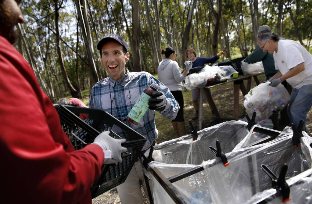 Gabriel de Balmann, who has autism, center, helps recycle bottles with his personal assistant Michael Whitaker, left, from Sweetwater Spectrum, a community for autistic adults, at Jack London State Park in Glen Ellen, on Thursday, April 9, 2015. (BETH SCHLANKER/ The Press Democrat) Sonoma Magazine