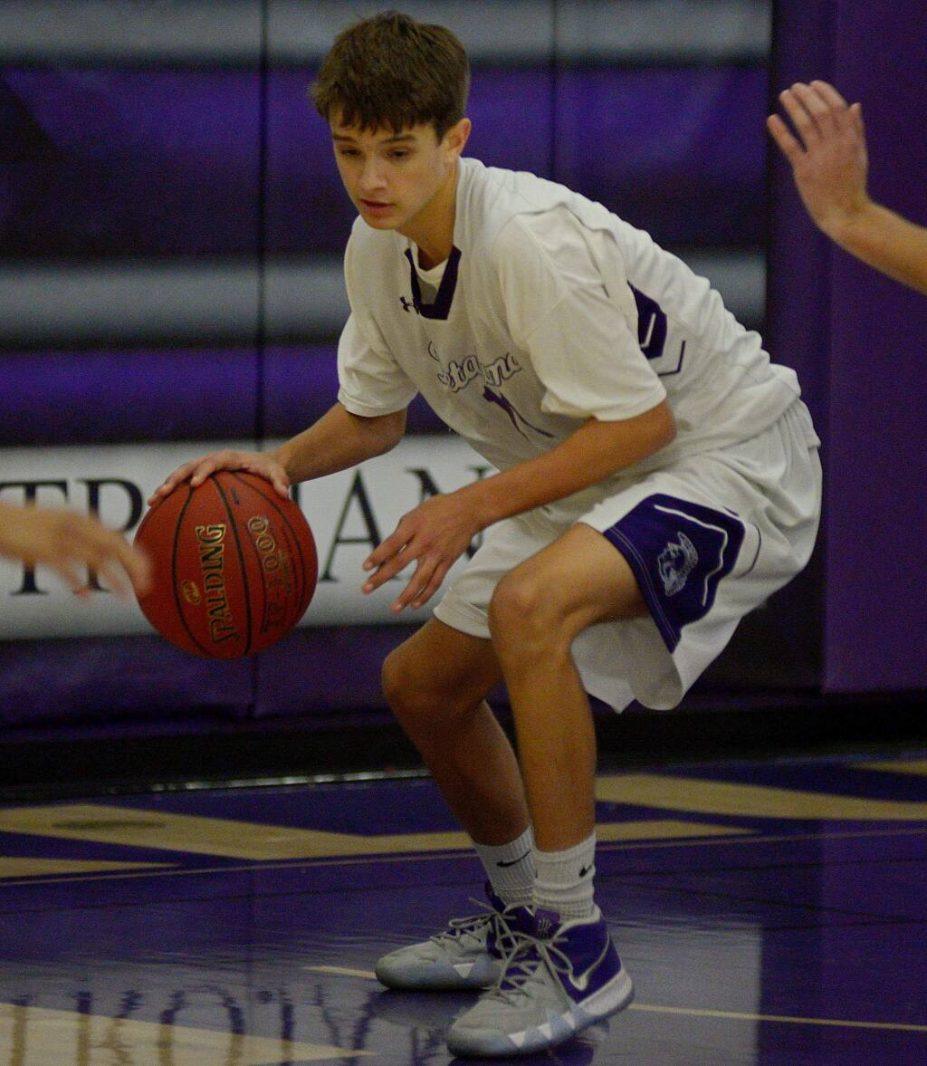 SUMNER FOWLER/FOR THE ARGUS-COURIERPetaluma's Ryan Giacomini made a miracle 4-point play to send the game into overtime and then hit another 3-point shot to lead the Trojan JVs to a 66-62 win over Casa Grande in the Wayne Douglas Junior Varsity Tournament.